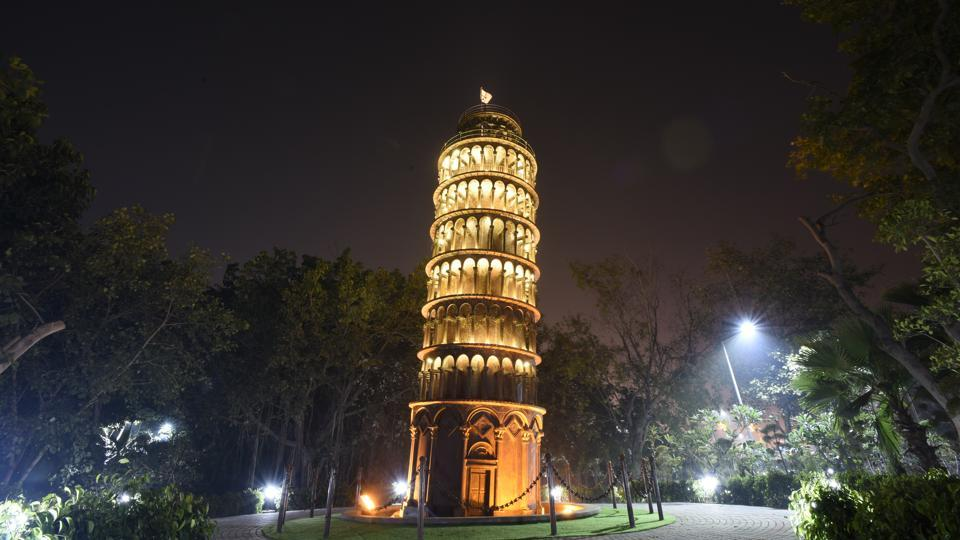 At eight times smaller than the Italian original's 57mtrs, the Leaning Tower of Pisa in Delhi should have a far easier time staying put. The seven monuments have been constructed at a combined cost of around Rs 5 crores. (Burhaan Kinu / HT Photo)