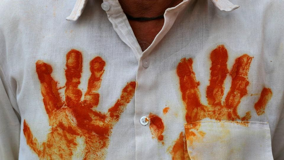 A devotee wears a shirt with turmeric handprints before a procession at shepherd god Khandoba's temple during 'Somvati Amavasya' in Jejuri, Maharashtra. (Danish Siddiqui / REUTERS)