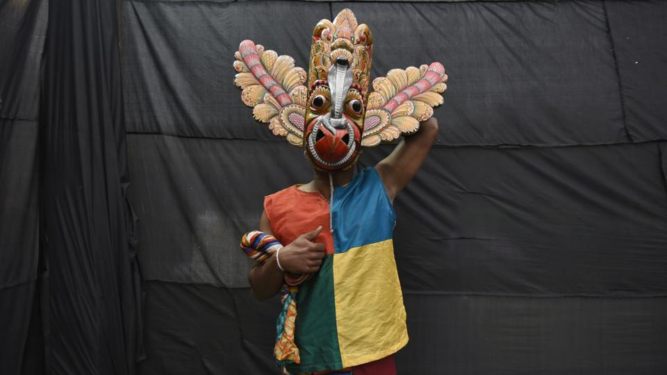 A member of the Sri Lankan Navy Dance Troupe poses for a photograph after getting ready at backstage to perform during the Sri Lanka Cultural Promenade organised by New Delhi Municipal Council (NDMC) in association with Sri Lanka High Commission, at Connaught Place, in New Delhi. (Burhaan Kinu / HT Photo)