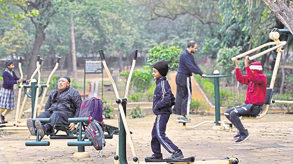 People exercise at an open-air gym at Ashoka Park, New Friends Colony, in New Delhi, on Thursday, February 7, 2019.
