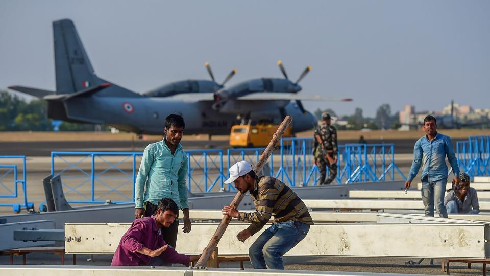 Workers prepare a temporary structure during preparations ahead of 'Aero India Show 2019', at Yelahanka Air Base station in Bengaluru.