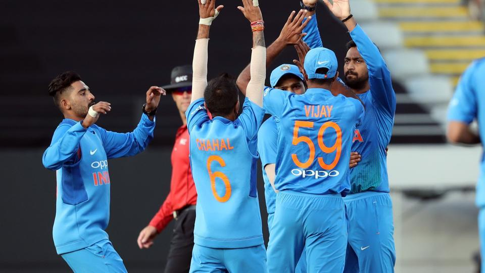 Indian players celebrate the wicket of New Zealand's Colin Munro during the second Twenty20 international cricket match between New Zealand and India in Auckland.