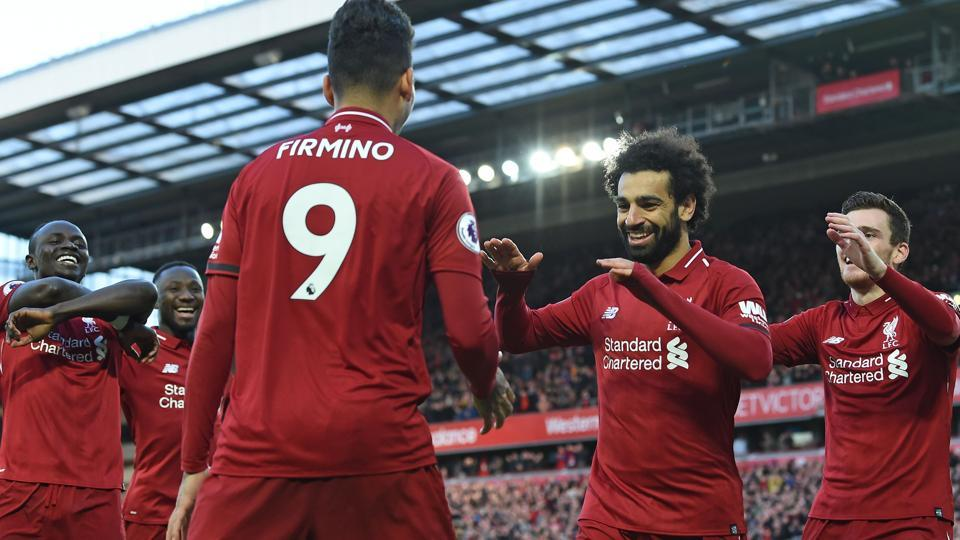 Mohamed Salah (2nd R) celebrates with teammates after scoring their third goal.