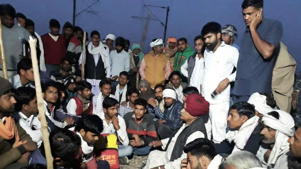 Gujjar leader K S Bainsla and his supporters sit on tracks at Malarna railway station in Sawai Madhopur in Rajasthan on Friday.