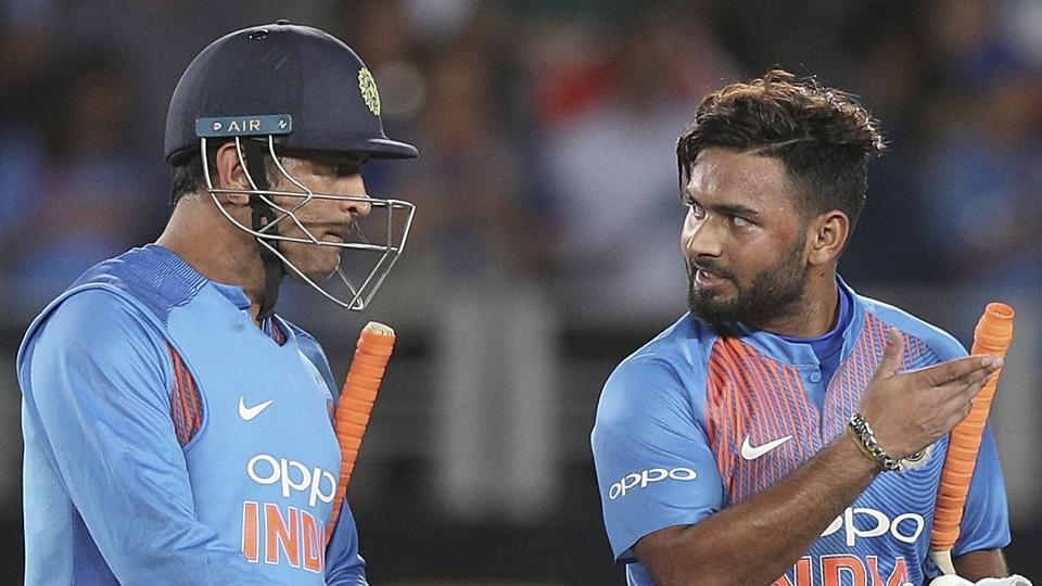 India's MS Dhoni, left, and Rishabh Pant walk off after winning their twenty/20 cricket international against New Zealand at Eden Park in Auckland.