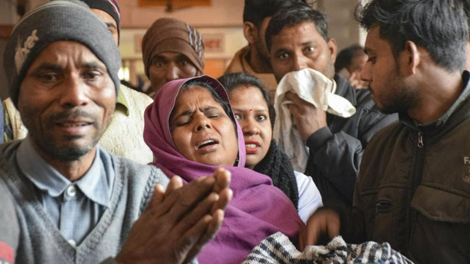 Family members of victims who are undergoing treatment on being poisoned after consuming a spurious liquor, at a hospital in Saharanpur, Saturday.