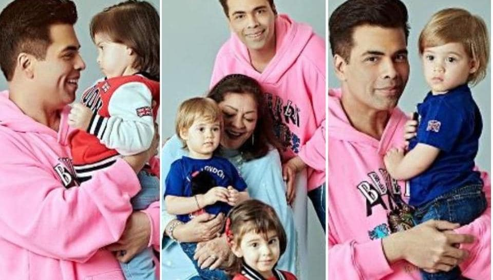Karan Johar poses with his twins, Yash and Roohi, and his mother, Hiroo.