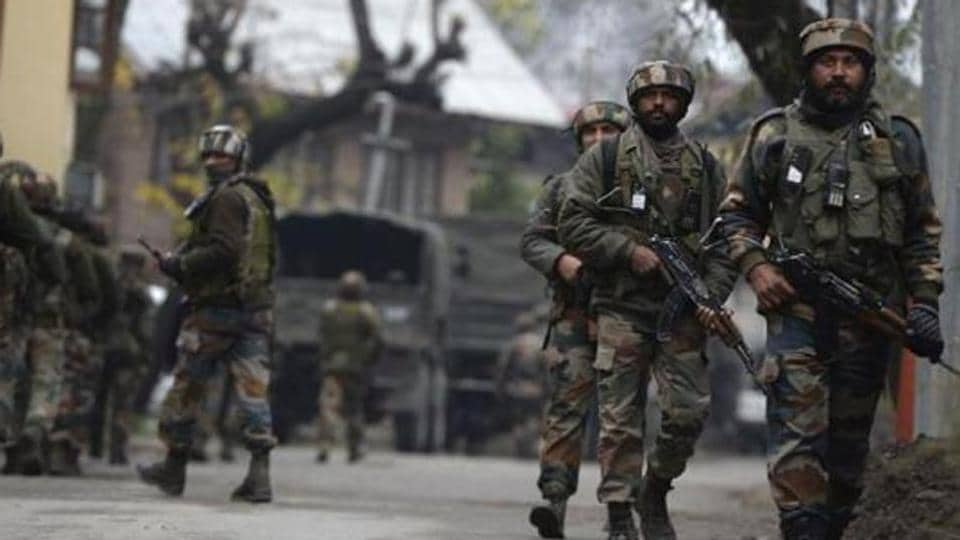 Indian army soldiers patrol during a cordon and search operation for suspected militants on the outskirts of Srinagar.