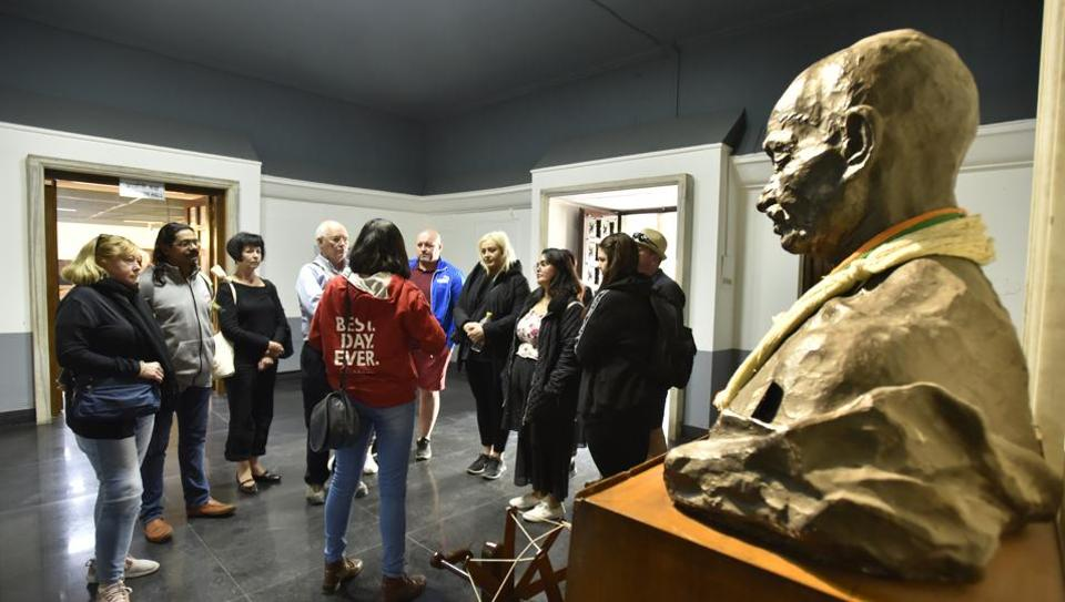 Tourists inside the Gandhi Museum, near Rajghat, in New Delhi. The national capital has, in recent years, emerged as a popular Gandhi tourism destination, with several tour companies taking foreign tourists on the Gandhi trail across the city. (Sanjeev Verma / HT Photo)