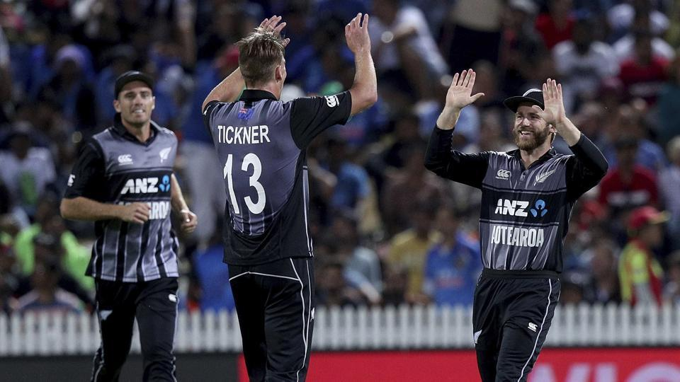 Blair Tickner, center, celebrates with Kane Williamson the wicket of India's Rishabh Pant. (AP)
