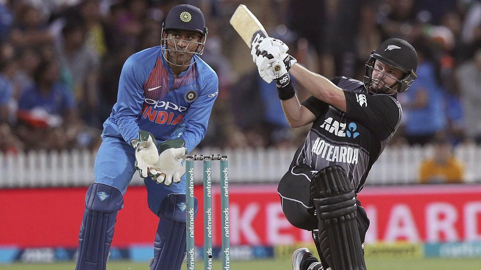 New Zealand's Colin Munro hits a four watched by India's wicketkeeper MS Dhoni. (AP)