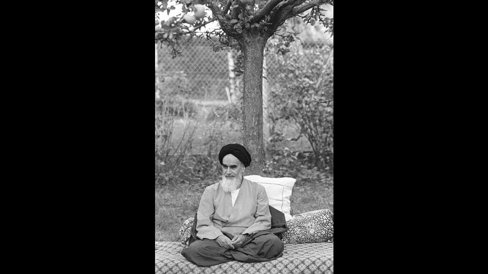 "Ayatollah Khomeini in his garden in Neauphle-Le-Château, near Paris, a few months before his triumphal return to Iran. From Paris, The Ayatollah called for resistance against the ""illegal"" military government. With the government in turmoil, anti-Americanism intensified sparking an exodus that reduced the number of Americans from 45,000 to 12,000 by January. (Joel Robine / AFP File)"