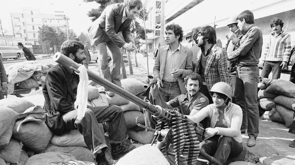 An Iranian woman sits at a heavy weapon in Tehran Street, on February 13, 1979. On February 11, Iran's general staff declared the neutrality of the armed forces and troops were ordered back to their barracks, guaranteeing the Islamic Revolution's success. The loss of the military doomed the Shapour Bakhtiar government, forcing the prime minister to eventually take exile in France. (Michel Lipchitz / AP File)