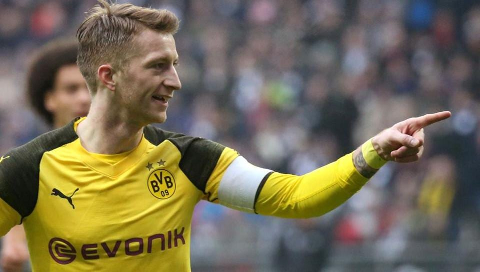 Dortmund's German forward Marco Reus celebrates scoring during the German First division Bundesliga football match between Eintracht Frankfurt v BVB Borussia Dortmund