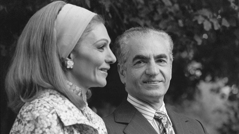 Mohammed Reza Pahlavi and his wife Farah Diba are seen in Marrakech, during their stay in Morocco on January 24, 1979. On March 6 that year, Iran announced that the shah will be tried in absentia. On March 30, millions of Iranians heeded Khomeini's call for a 'yes' vote in a referendum replacing the monarchy with an Islamic revolutionary state. (Pierre Guillaud / AFP File)