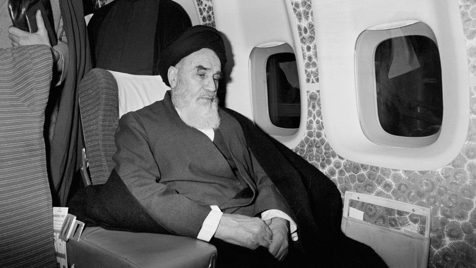 Ayatollah Ruhollah Khomeini inside an airplane in Paris before flying back to Iran after 14 years of exile. Iran entered October 1978 with strikes by civil servants nationwide. Khomeini was forced to leave Iraq for France where he had lived in exile since a failed revolt against the 1963 land reform that deprived the clergy of land holdings. (Thierry Campion / AP File)