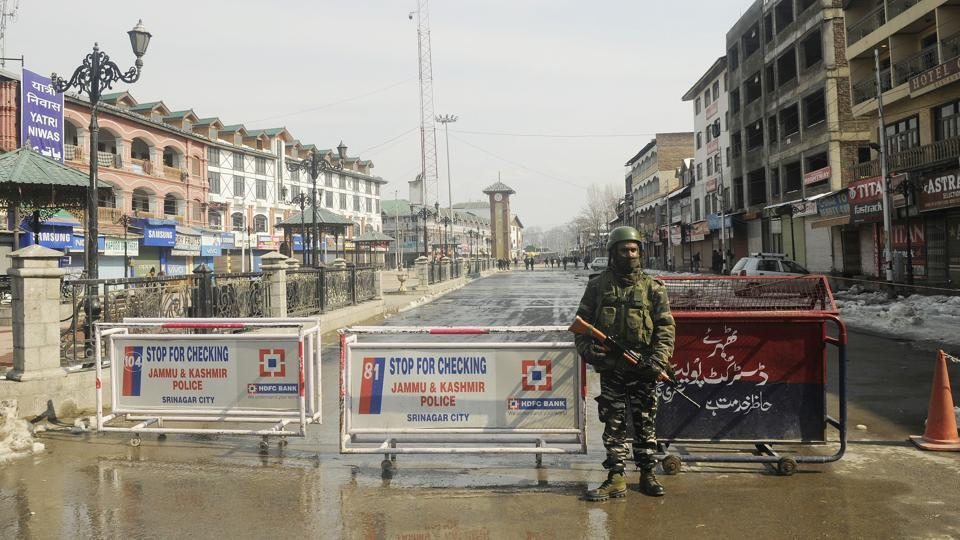 A paramilitary solider stands guard during a strike called by separatists to mark the 35th death anniversary of JKLF founder Mohammad Maqbool Bhat, who was hanged on this day in 1984 in Delhi's Tihar jail. Shops and other business establishments remained closed while public transport was off roads due to the shutdown, officials said. (Waseem Andrabi / HT Photo)