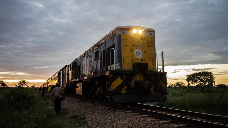A commuter train known as the 'Freedom Train' approaches a station early morning in Cowdray Park township, in Bulawayo, Zimbabwe. Chugging through townships, maize fields and scrubland as the sun rises, Zimbabwe's only commuter train is cheap and reliable -- two qualities that its passengers cherish in a downwards-spiralling economy. (Zinyange Auntony / AFP)