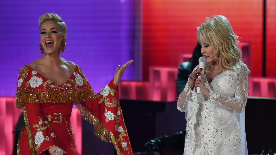 US singers Katy Perry (L) and Dolly Parton perform onstage during the 61st Annual Grammy Awards on February 10, 2019, in Los Angeles.