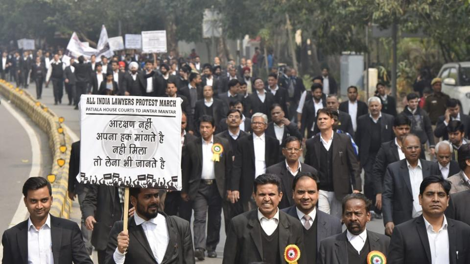 Lawyers in Delhi took part in a march from Patiala House Court to Jantar Mantar, part of a nationwide strike called by the Bar Council of India, demanding allocation of Rs 5,000 crore in the budget for the welfare of advocates. (Vipin Kumar / HT Photo)