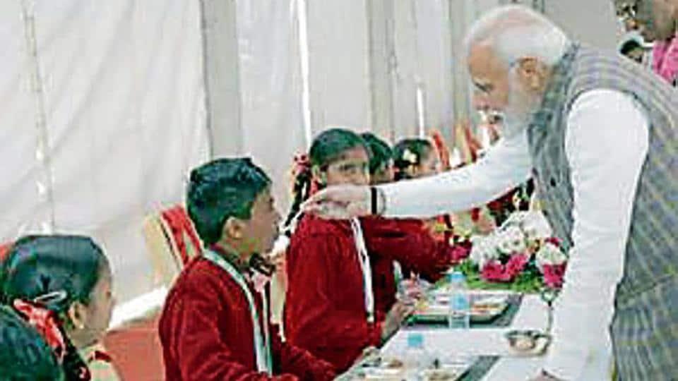 PMNarendra Modi feeding children at a function to mark the three billionth meal of the Akshaya Patra Foundation