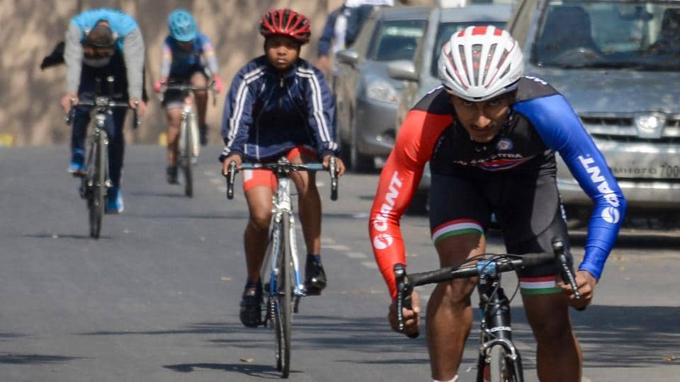 Hanuman Chopade (right) of Maharashtra in action during 24 Km boys mass start event in the under-17 category at 64th National School Games (cycling - road) Championship at Hinjewadi on Sunday.