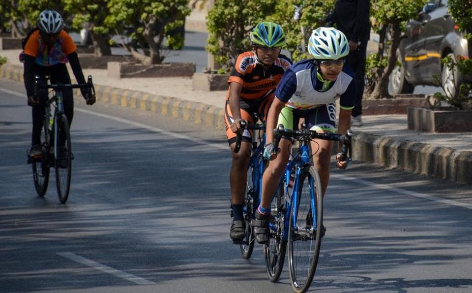 Maher Patel (in white and blue) from Pune in action during the 12 km girls mass start event in the under 14 category at 64th National School Games (cycling - road) championship at Hinjewadi on Sunday.