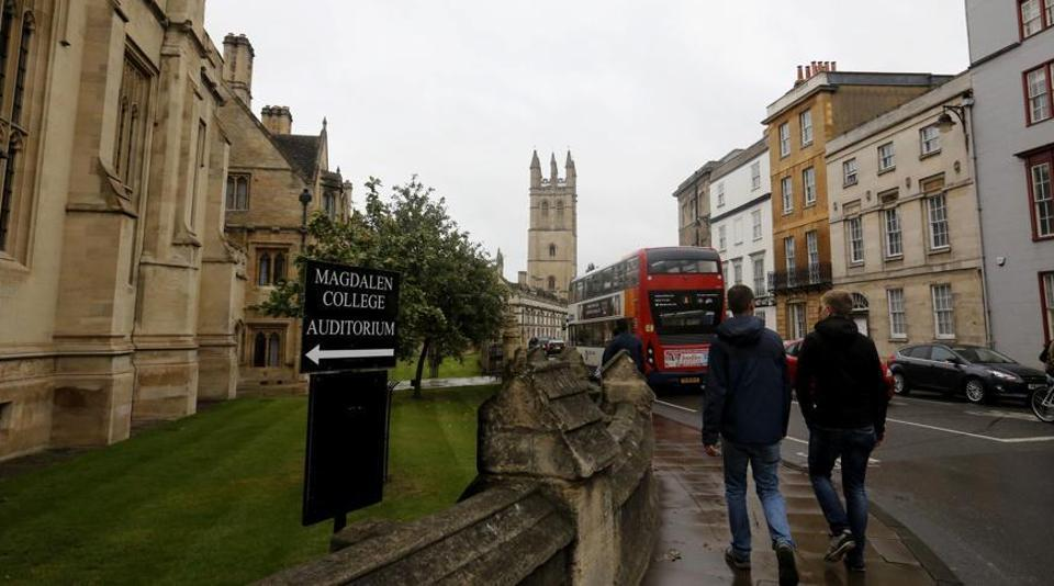 People walk around Oxford University's campus in Oxford, England.  Image for representation.