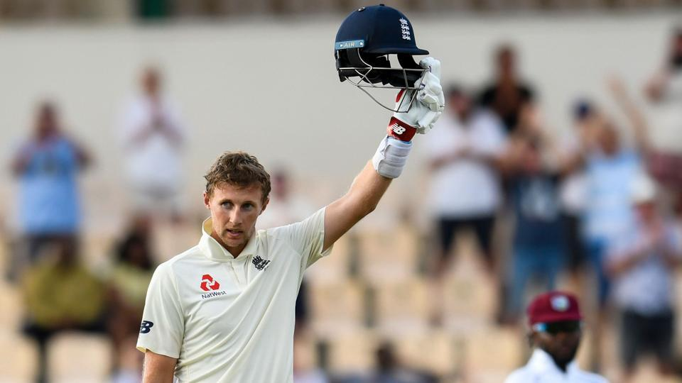 Joe Root of England celebrates his century against the West Indies.
