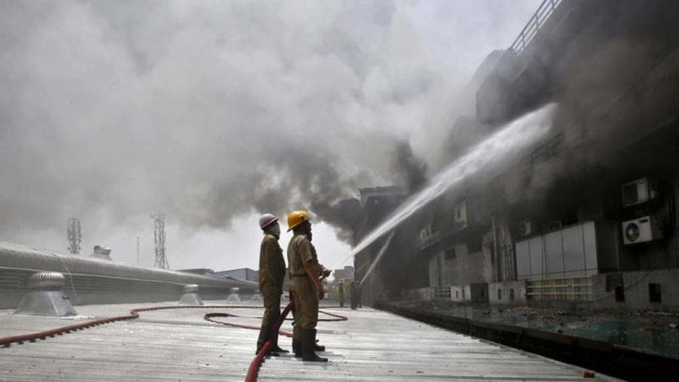 Firefighters try to extinguish a fire that broke out in a plastic factory in New Delhi.