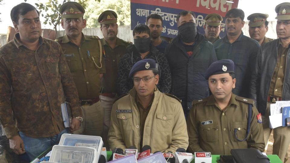 Two of the arrested gang members in Ghaziabad police custody. Police said they were arrested from Moradabad.