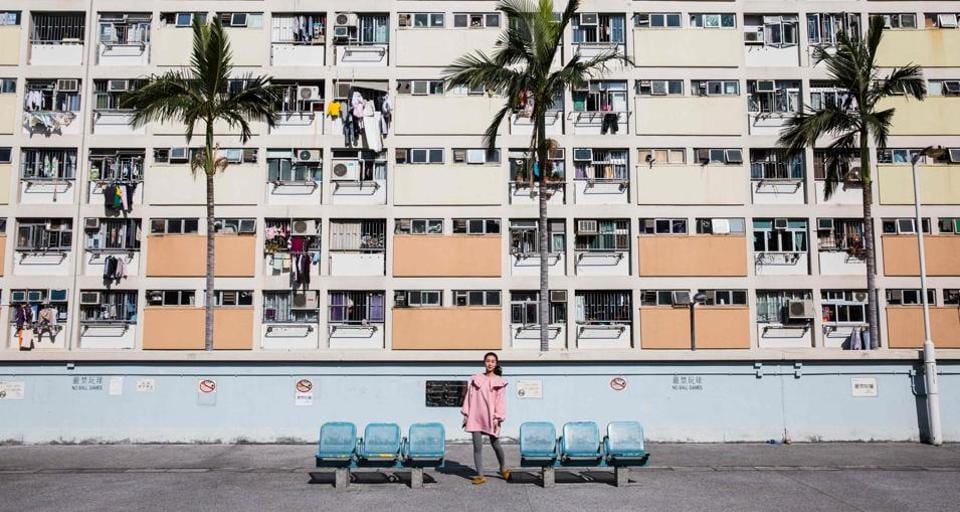 A woman posing for a photo at a popular Instagram spot in Hong Kong.