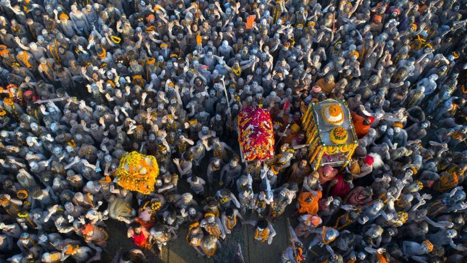 On so-called 'Shahi snan' or royal bathing days, the Naga Sadhus lead the 13 monastic orders' processions — on garlanded horses, elephants and tractors — through the festival grounds and into the river, armed with tridents and swords. (Rajesh Kumar Singh / AP)