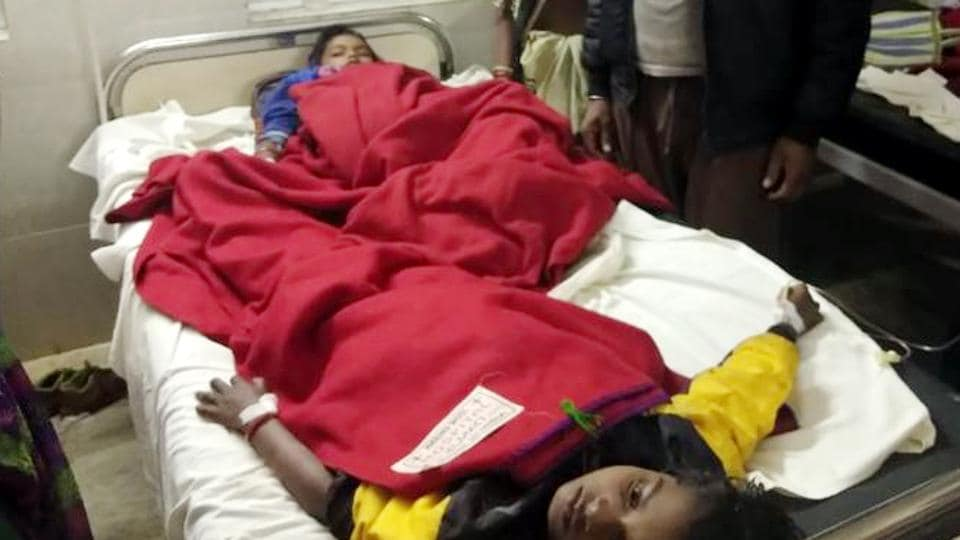 Young victims of food poisoning being treated at Sadar hospital after in Lohardaga, India, on Sunday