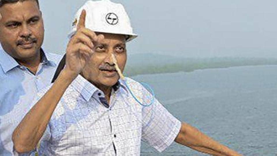 Goa chief minister Manohar Parrikar inspects the work ofan under-construction bridge on Mandovi River on December 16.