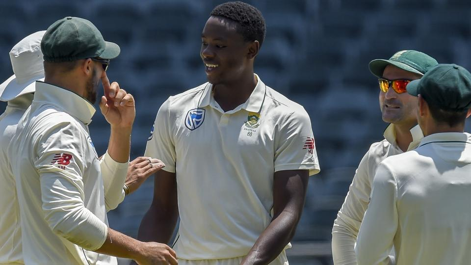 South Africa's bowler Kagiso Rabada, centre, is congratulated after dismissing Pakistan's Faheem Ashraf .