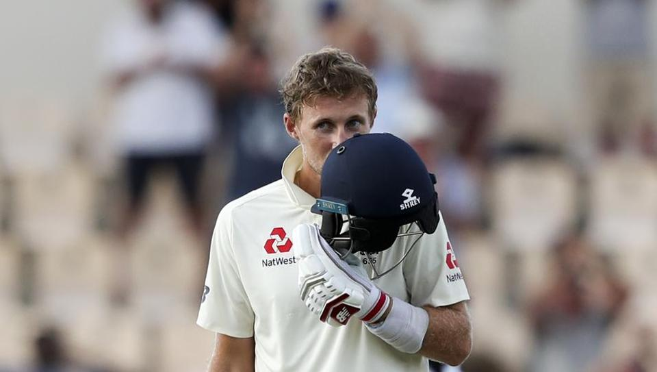 England's captain Joe Root celebrates after he scored a century against West Indies during day three of the third cricket Test match at the Daren Sammy Cricket Ground in Gros Islet, St. Lucia