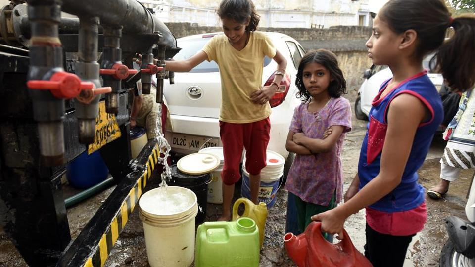 Children filling water cans  at Anand parvat area in New Delhi. The national capital faces a water supply crisis every summer.