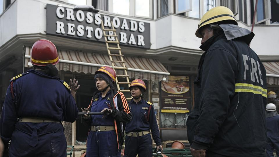 Firefighters seen outside Hotel Arpit Palace after a massive fire broke out at the hotel, at Karol Bagh, New Delhi, on Tuesday, February 12, 2019.