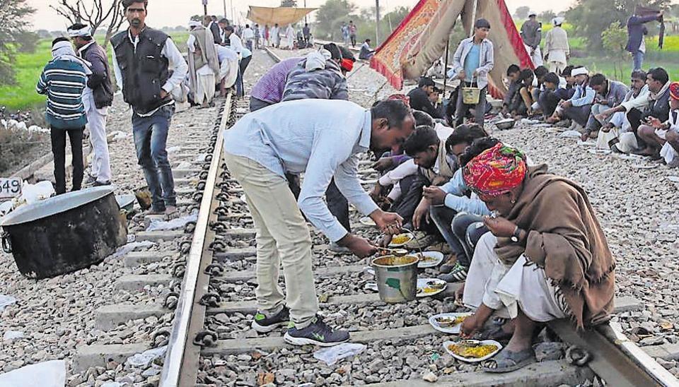 Gujjar protesters, demanding quota in education and jobs,  camping on rail tracks at Maksudanpura, near Malarna Dungar railway station, in Sawai madhopur on Monday 11 February 2019.