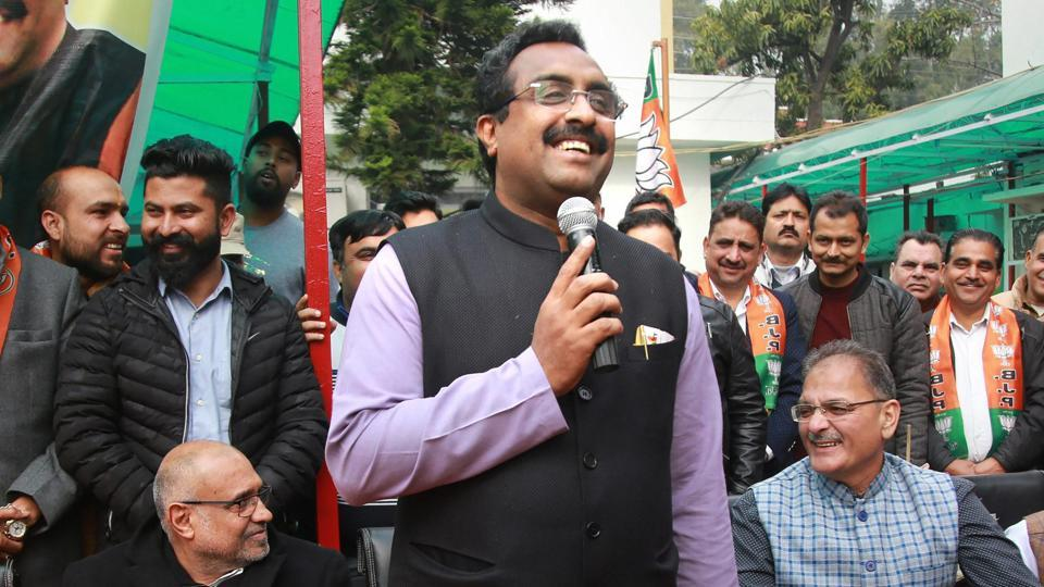 BJP National Gen Secretary Ram Madhav addresses a gathering after hoisting party flag during the launch of 'Mera Parivar Bhajpa Parivar' campaign, in Jammu.