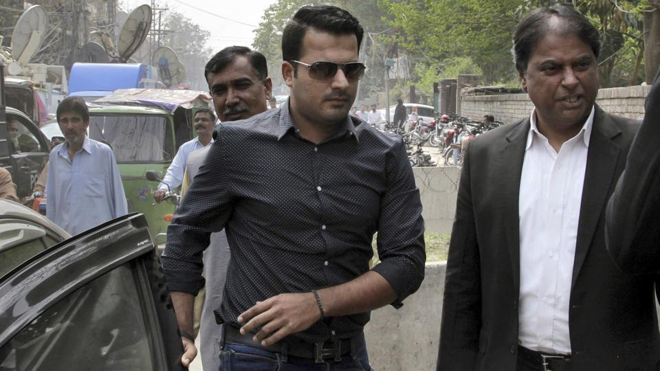 harjeel Khan, center, arrives at the office of Federal Investigation Authority for recording his statements.