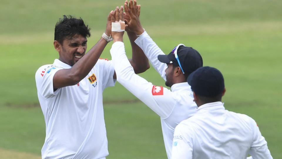 Suranga Lakmal of Sri Lanka celebrates the wicket of Hashim Amla of South Africa with his team mates.