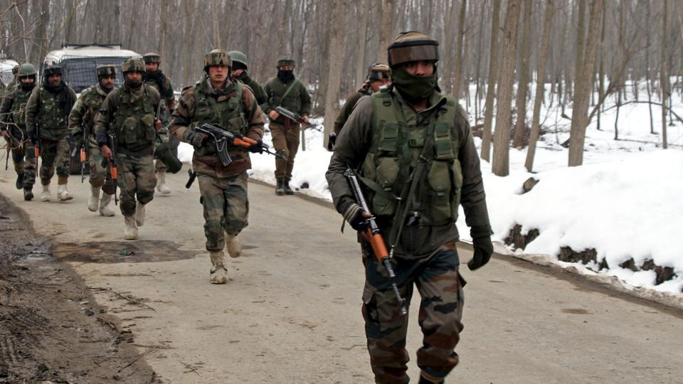Army soldiers near the site of encounter at the Ratnipora area of south Kashmir's Pulwama district on February 12, 2019.  At least two militants were killed in an encounter with security forces in central Kashmir's Budgam, police claimed on Wednesday.