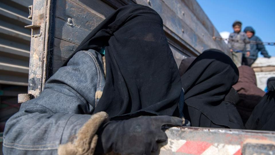 """Women and children displaced from Deir Ezzor sit in the back of a truck after they fled the Islamic State (IS) holdout near Baghouz, eastern Syria. Among the fleeing were those born in a """"state"""" that no longer exists, most to fathers who are dead and mothers whose countries don't want them back. These are the children pouring out of Baghouz. (Fadel Senna / AFP)"""
