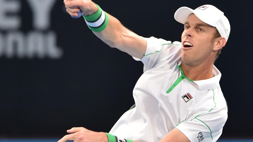 Sam Querrey of the US hits a return to Gilles Simon of France.