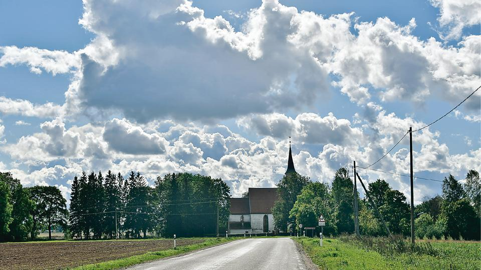 Latvian countryside is dotted with small villages and many of them have their own church