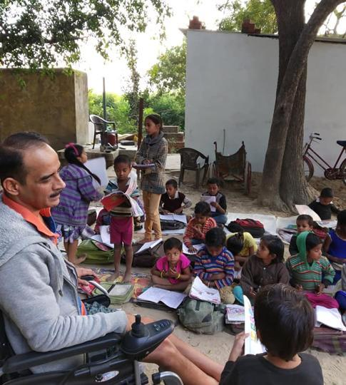 Varanasi's wheelchair-bound Gopal Khandelwal, who found the love of his life 20 years ago, when he took to teaching children in a village near Mirzapur.