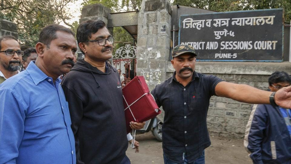 Activist Anand Teltumbde (black pullover) leaves after Pune District and Sessions Court released him in Bhima Koregaon case, in Pune.