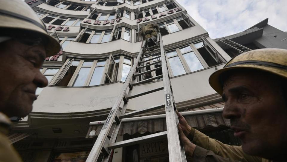 Fire brigade personnel at work after a massive fire broke out at Hotel Arpit Palace, Karol Bagh in New Delhi,  on Tuesday, February 12, 2019.